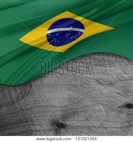 Brazilian flag on wood background