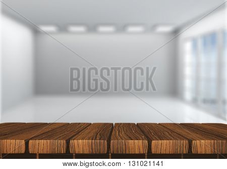 3D render of a wooden table looking into a defocussed empty room