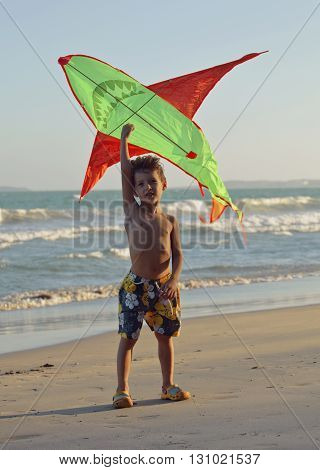 little cute boy, sunset at the seacoast with kite, adorable kid, lifestyle people concept, summer vacation