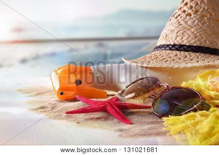 Sun Protection Articles On Table In Terrace Overlooking Beach