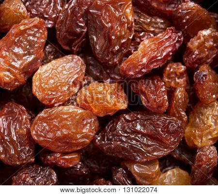 Tasty raisins as an abstract background texture.