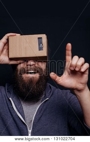 Color Shot Of A Young Man Looking Through Card Board