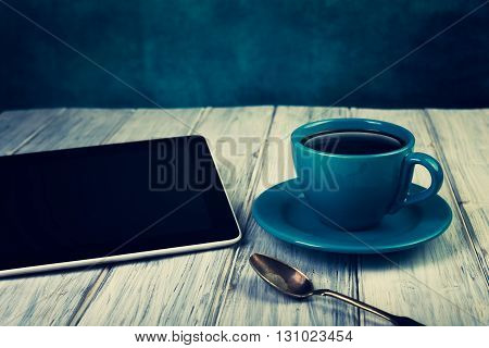 Coffee And Tablet On The Table