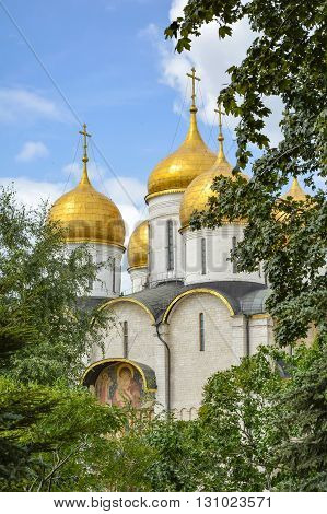Dormition Cathedral view through the trees of the Kremlin gardens