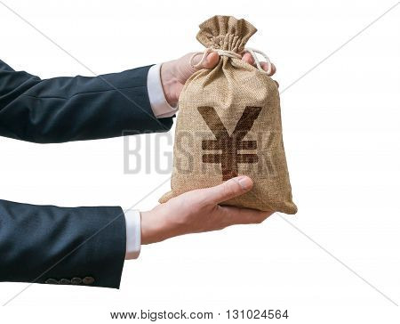 Hands Of Businessman Holds Bag Full Of Money With Yen Sign. Isol