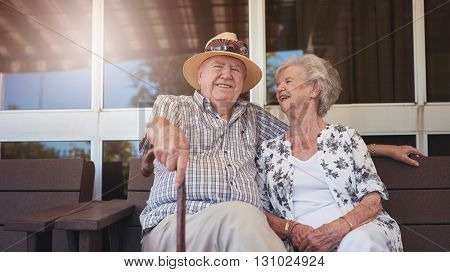 Retired Couple Taking A Break And Relaxing Outdoors