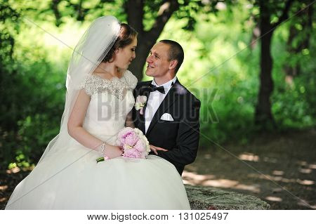 Portrait Of Fashionable Wedding Couple At Wood Background