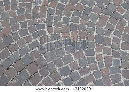 A cobblestone pavement useful as a background