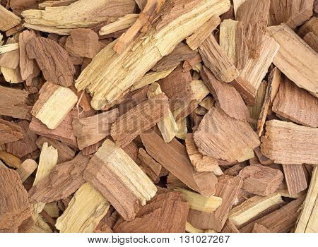Close view of mesquite wood smoking chips for flavoring barbecue and grilled foods.