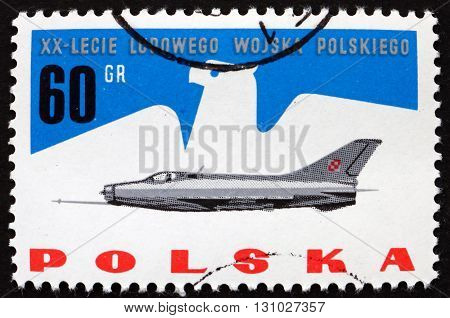 POLAND - CIRCA 1964: a stamp printed in the Poland shows Eagle and Jet Fighter Polish Peoples' Army 20th Anniversary circa 1964