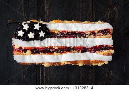 Fourth Of July Themed Berry Pastry On A Rustic Wooden Background