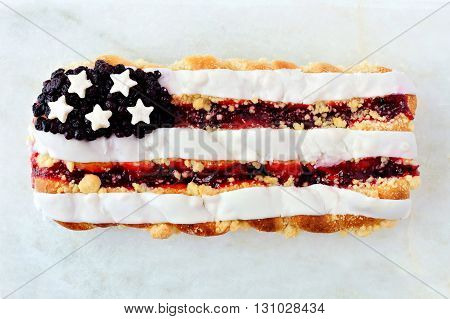 Fourth Of July Themed Berry Pastry On A White Marble Background