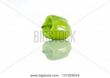 One Green Pepper On A White Background