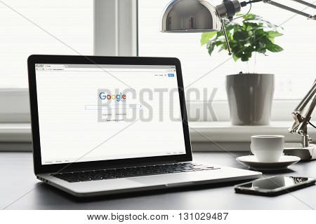 Macbook Pro With Google App On Screen