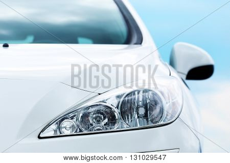Auto parts, front headlights on a blue sky background