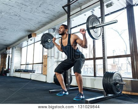 Muscular Fitness Man Doing Heavy Exercise using barbell in the gym