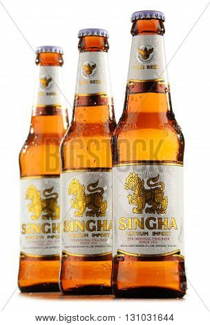 Three Bottles Of Singha Beer Isolated On White