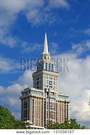 Top of the huge residential building with white spire