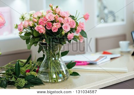 Bouquet of pink and white roses in vase on the table