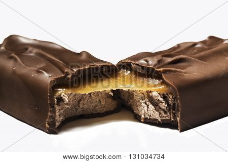 Closeup of chocolate bar isolated on white background