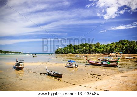 Long-tail boats on Rawai beach at low tide Phuket Thailand