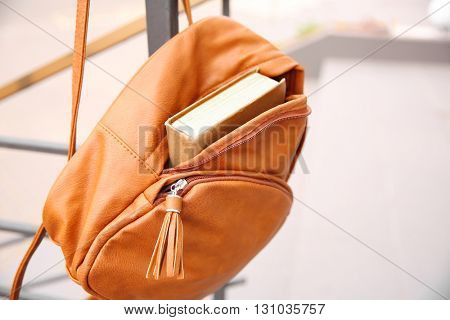 Hanging backpack with book closeup