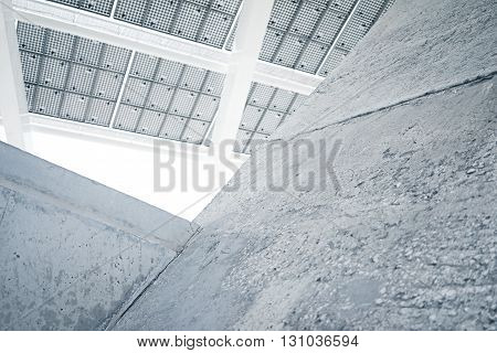 Horizontal Photo Modern Solar Panel with Blank Light Concrete Blocks. Contemporary Building Architecture. Empty Abstract background