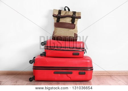 Suitcases on white wall background