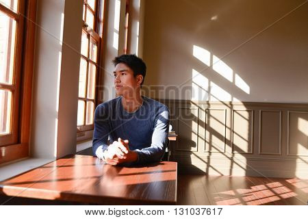 Relaxed young man at home, sitting on coffee shop