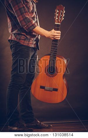 Man Is Standing With Guitar.