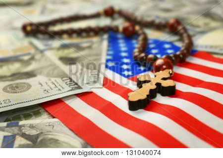 American flag with dollars and rosary beads, closeup