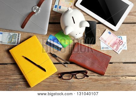 Business things and money on wooden background