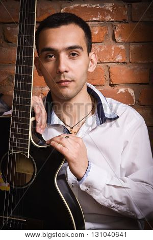 Hispanic Man Holding Acoustic Guitar