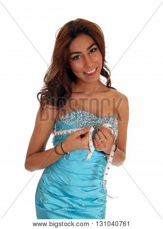 A beautiful young woman in a blue evening dress measuring her breast's isolated for white background.