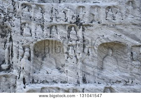 Buddhist stone carvings within longmen grottoes in Luoyang China in henan province.