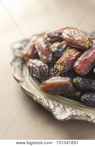 Fine quality Mabroom dates in vintage plate.