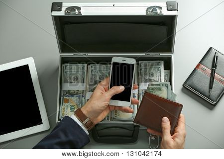 Businessman with wallet, money and accessories