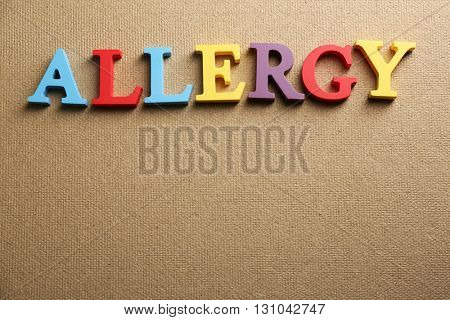 Word ALLERGY on textured background