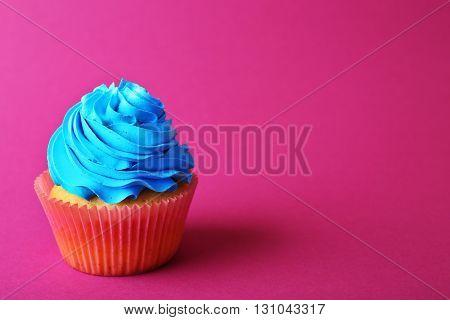 Birthday cupcake on pink background