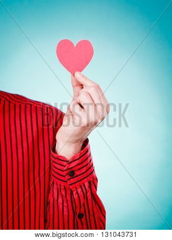 Person Holding Heart Cutout.