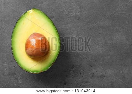 Avocado on grey background, top view