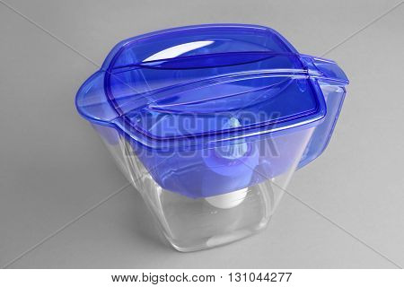 Water filter jug on the grey background