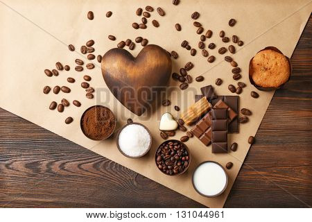 Coffee, sugar and milk on parchment, top view
