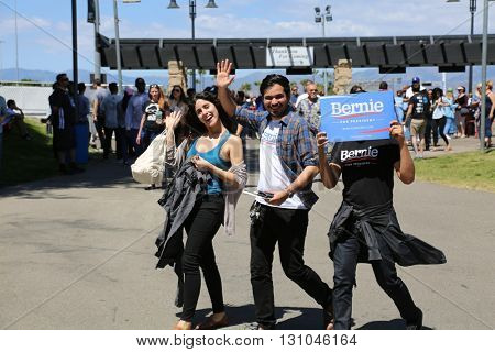 IRVINE, CALIFORNIA - May 22: Fans Smile, Wave and Show their Signs and T-Shirts as they enter Irvine Meadows Amphitheater at a Bernie Sanders Rally in Irvine, California on May 22, 2016