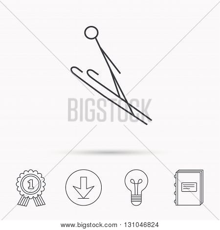 Ski jumping icon. Skis extreme sport sign. Professional competition symbol. Download arrow, lamp, learn book and award medal icons.