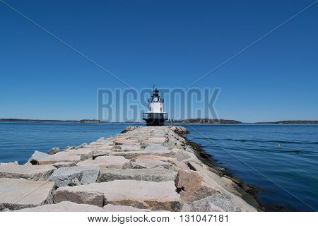 Lighthouse with a blue sky and sea wall