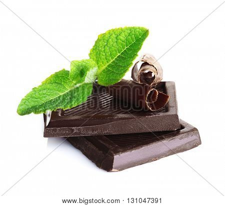 Slice and chips of chocolate with fresh mint, isolated on white