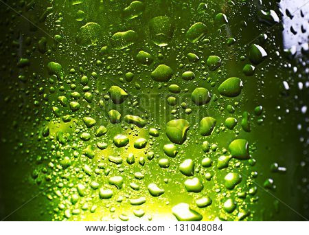 Green bottle of fresh beer, closeup