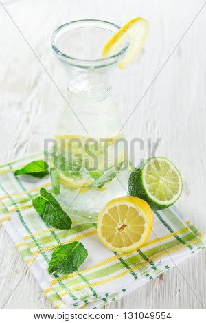 Soft drink, lemon and limes fruits.
