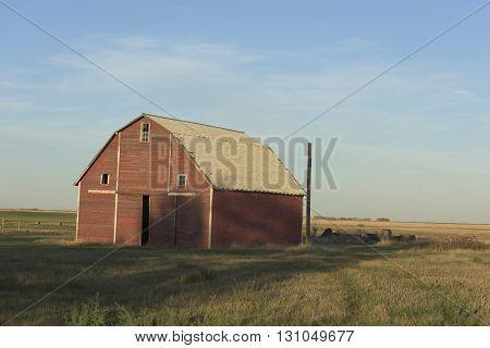 An old red barn on the prairie in North Dakota